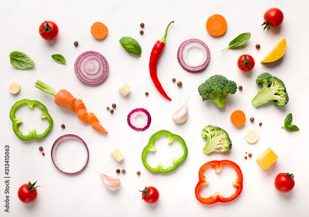 Fototapeta Healthy flat lay of sliced vegetables composition