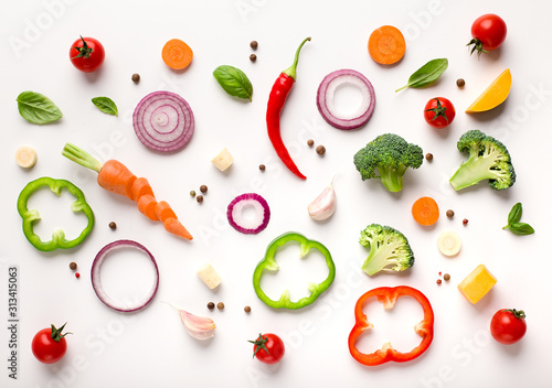 Healthy flat lay of sliced vegetables composition Fototapeta