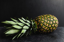 One Whole Pineapple On Dark Ba...