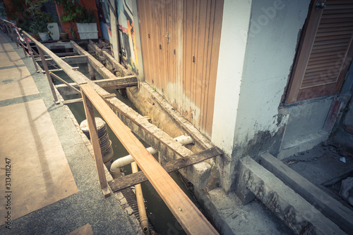 Boardwalk with under deck drainage remodeling along Malacca River, Malaysia Wallpaper Mural