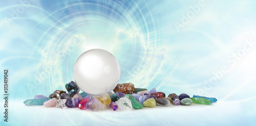 Photo Magical Healing Crystal Vortex Background - a large clear crystal ball atop a se