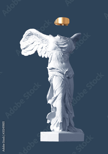 Fototapeta 3D Model Of Winged Victory With Golden VR Glasses On Blue Background obraz