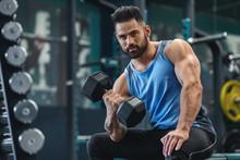 Handsome Bodybuilder Picking U...