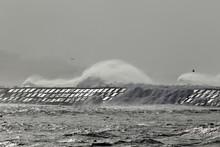 Big Spraying Waves Approaching A Pier
