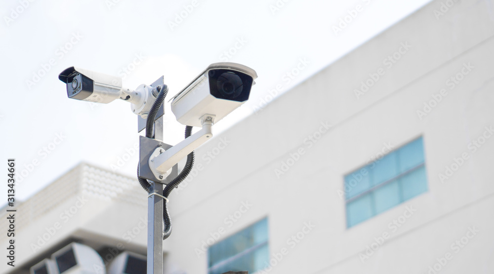 Fototapeta CCTV surveillance security camera video equipment on pole outdoor building safety system area control and copy space