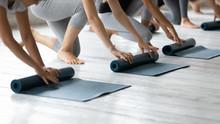 Diverse People Folding Yoga Ma...
