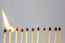 Line Of Matches Igniting In A ...