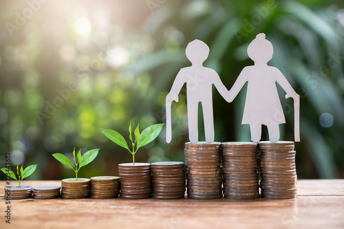 Fototapeta old couple model standing on money coins saving for concept investment mutual fund finance and pension retirement  obraz