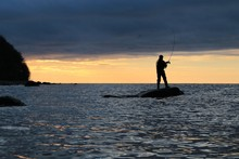 Silhouette Of Man On A Rock Ca...