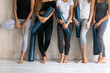 Group diverse sporty women with yoga mats standing in gym