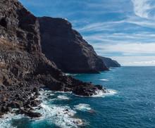 High Steep Volcanic Rock Cliff...