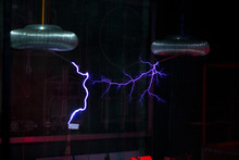 Artificial Lightning From Tesla Coils Over The Layout Of The City
