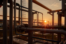 Gas Industry. Pipeline System At Gas Processing Plant Illuminated By The Rays Of The Rising Sun