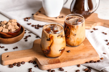 Glasses of tasty cold coffee on table