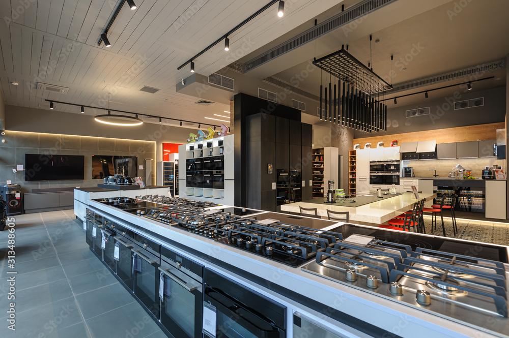 Fototapeta Brand new gas stoves in apliance store showroom
