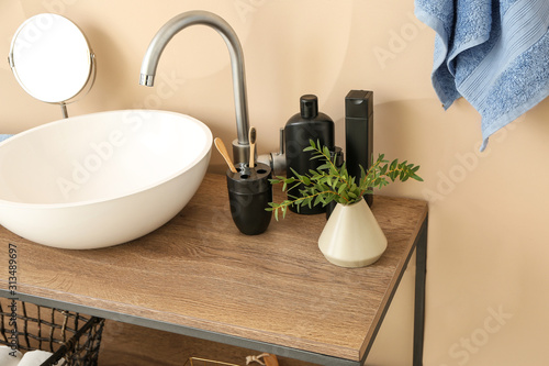 Obraz Body care cosmetics with accessories near sink in bathroom - fototapety do salonu