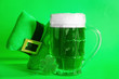 canvas print picture - Mug of green beer for St. Patrick's Day and leprechaun's hat on color background