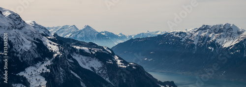 Fényképezés swiss alps during winter with mountains and trees covered with snow