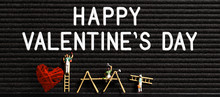 Painter Figure With HAPPY VALENTINES DAY Message On A Letter Board