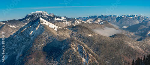 Mountain View from a Bavarian Top Point to the surrounding alp scenery during winter #313496815