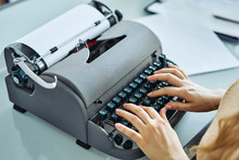Close Up Of Woman Typing With Old Typewriter