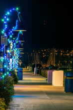 Holiday Lamps Decorated Like Candy Canes Along The Harbor Sidewalk Illuminating The Walking Path.
