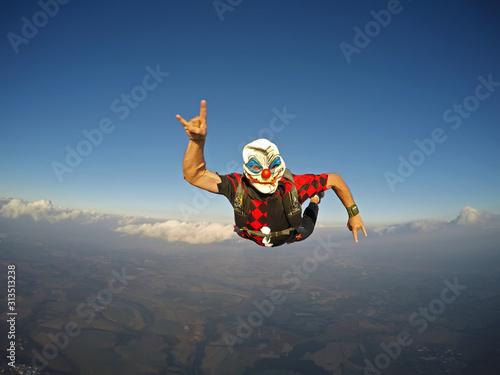 Parachutist dressed as a clown on Halloween. #313513238