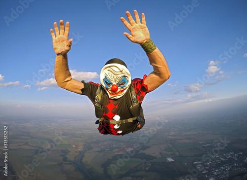 Parachutist dressed as a clown on Halloween. #313513262