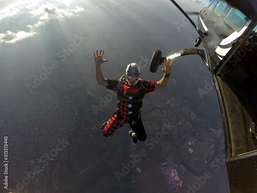 Parachutist dressed as a clown on Halloween. #313513440