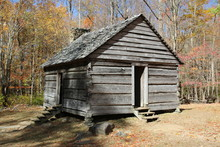 An Old Wooden Log Cabin In The...