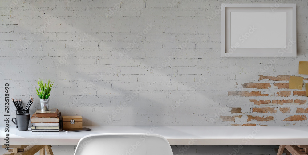 Fototapeta Top view of comfortable vintage workplace with office supplies and copy space on white table and brick wall
