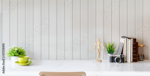 Obraz Modern stylish workplace with office supplies and copy space on white table and grey plank wall - fototapety do salonu