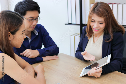 Confident young Asian investment advisor business woman discussing to her client.