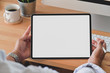 canvas print picture Cropped shot of young man holding blank screen digital tablet