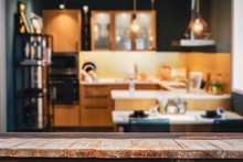 Wood Table With Blur Kitchen R...