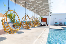 Swing Chair Sides Swimming Pool On Rooftop