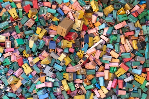Photo many color and size of automobile fuse for recycling.