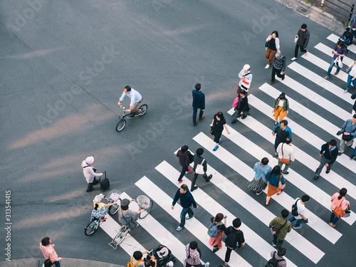 People walking Crosswalk street Sign Business area Japan Tokyo city