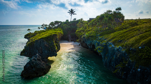 Hidden beach between cliffs in Zanzibar Tanzania. Canvas Print