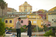 young Happy Asean moslem couple takes a photo against the colorful buildings and the river of Valencia, Spain