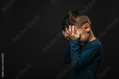 Fototapeta child whose depression is on a black background obraz
