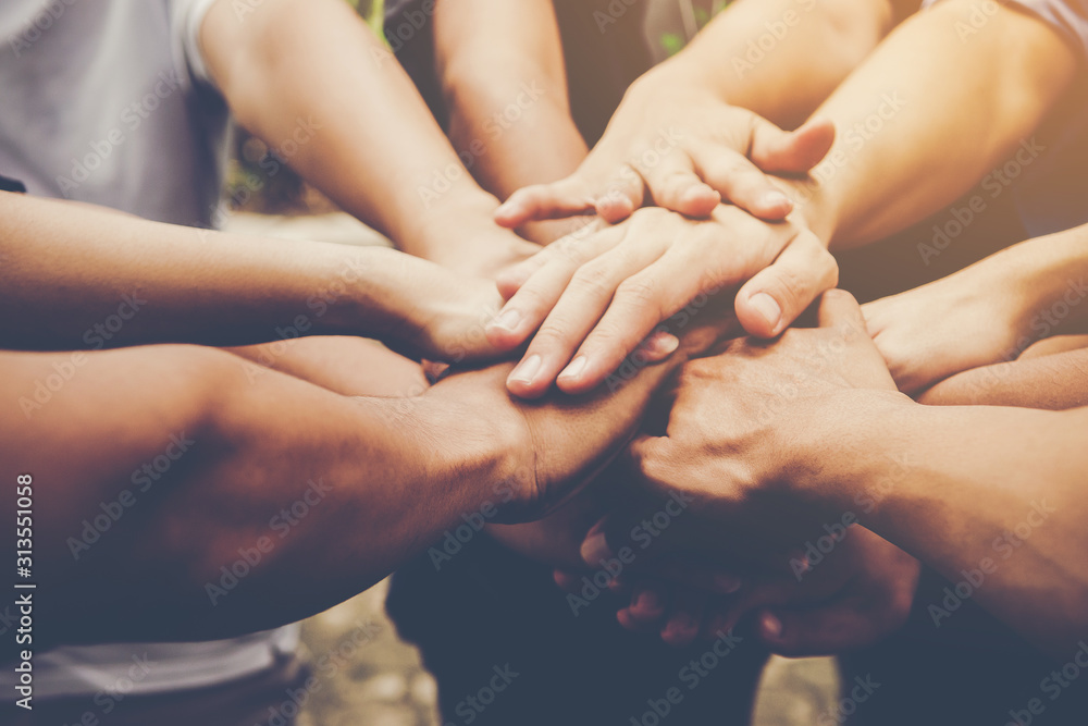 Fototapeta Business teamwork join hands together. Business teamwork concept