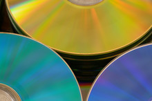 Yello, Teal And Blue Cds In A Pile