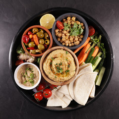 hummus, dipping sauce, olive and pita bread