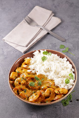 shrimp cooked with coconut cream and spice with rice