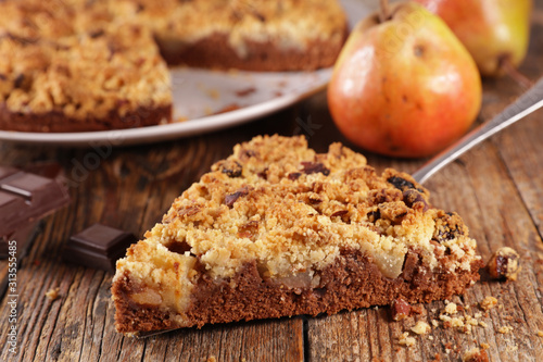 crumble with pear and chocolate on wood background Canvas Print