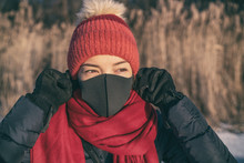 Winter Smog Bad Air Pollution Asian Woman Wearing Mask To Breathe Outside Cold Air.