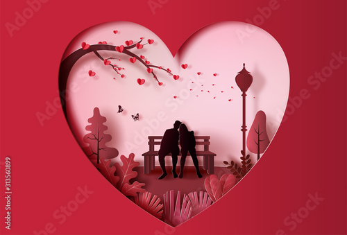 Young couple in love sitting on a bench in park, paper art style.