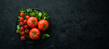 Fresh Red Tomatoes On A Dark Background. Vegetables. Top View. Free Space For Your Text.