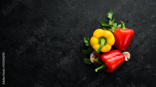 fresh-bell-pepper-on-a-black-stone-background-top-view-free-space-for-your-text